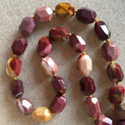 Knotted mookaite jasper necklace.